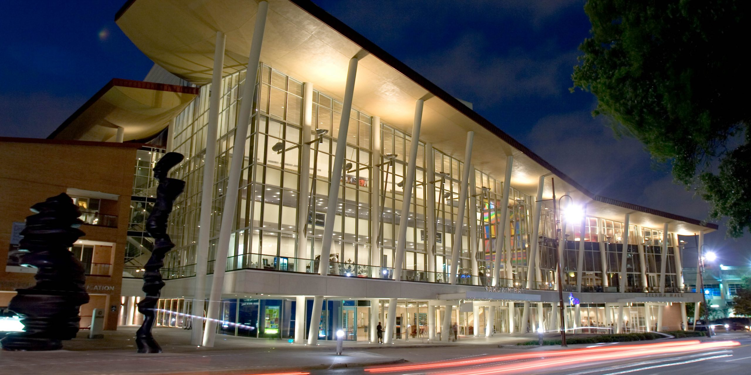 Exterior view of the Hobby Center for the Performing Arts at night.