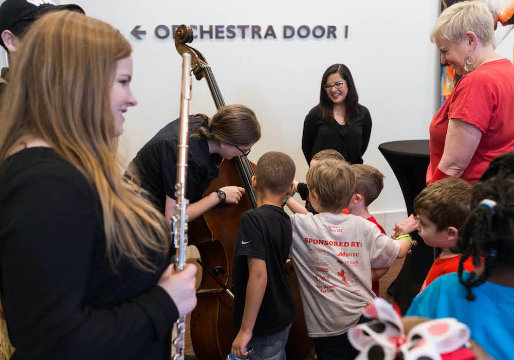 Adults showing children instruments